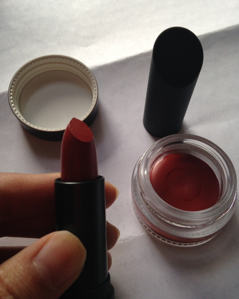 And voila! This is my lipstick. They don't normally give you the pot on the right, but, girl you know I'm all about waste not want not and I did pay $40 for this so I expect to have every drop of that lipstick.... Cool right?